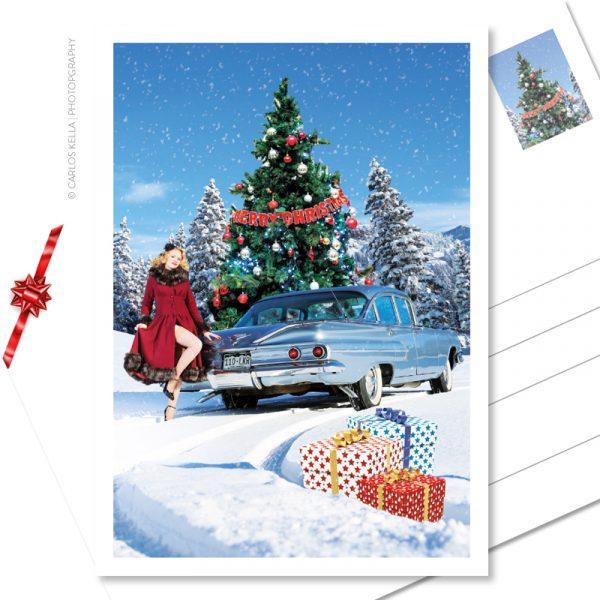 """Postkarte """"Merry X-MAS"""" – Der weihnachtliche Postkarten-Gruß für alle US-Car- und Modern Pin-up-Fans. Kalendermodel Lady Bella Bionda und ein Chevrolet Bel Air von 1960 im Schnee"""